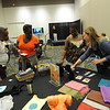 Women of the ELCA @ ELCA Youth Gathering | Detroit, Michigan, July 15-19 2015 | Guests to the Adult Leaders cafe peruse the items on the WELCA shop table.