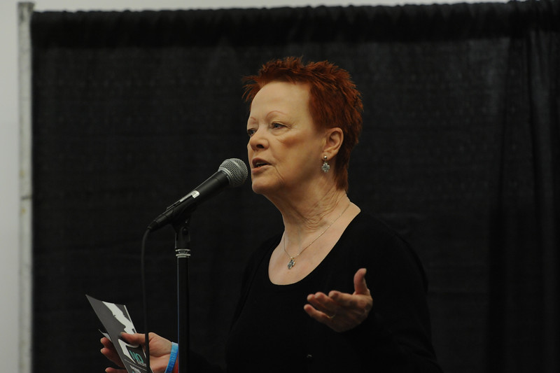 Women of the ELCA @ ELCA Youth Gathering   Detroit, Michigan, July 15-19 2015   Patti Austin, Churchwide executive board president, welcomes adult leaders to the cafe before presentations by representatives from three local anti-trafficking organizations.