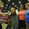 Women of the ELCA @ ELCA Youth Gathering | Detroit, Michigan, July 15-19 2015 |  Candie Yon, Children Without Hair cuts Sarah Guy's hair while her mom, The Rev. Juli Lejman-Guy and grandmother, Carolyn Steinfeldt, Zion Lutheran, Sandusky, Oh., watch her as her new haircut evolves.