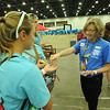 "Women of the ELCA @ ELCA Youth Gathering | Detroit, Michigan, July 15-19 2015 | Carol Rosenberger, Reformation Lutheran, New Market, Va., hands out ""break chains"" pins and talks to youth in the Community Life area. When asked if she was active in WELCA, she replied, ""I'm not but I need to be."""