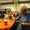 Women of the ELCA @ ELCA Youth Gathering | Detroit, Michigan, July 15-19 2015 | Pastor Barbara Barry, Quickel Lutheran, York, Pa. fills out contact cards in the Adult Leaders space.