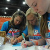 Women of the ELCA @ ELCA Youth Gathering | Detroit, Michigan, July 15-19 2015 | Sarah Gerber, Trinity Lutheran, Moorhead, Minn., Erin Eideness and Catie Kallander write a note of encouragement to place in hygiene bags for local organizations.