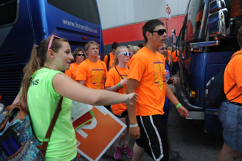 Women of the ELCA @ ELCA Youth Gathering | Detroit, Michigan, July 15-19 2015 |  Brittany Acos, Chesapeake, Va., First Lutheran, Norfolk, leads Proclaim Justice participants to their scheduled bus.