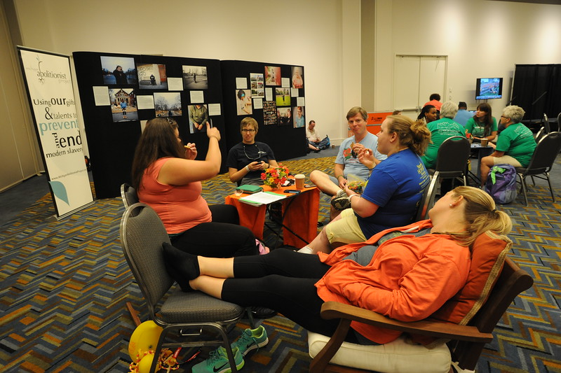 Women of the ELCA @ ELCA Youth Gathering | Detroit, Michigan, July 15-19 2015 | Erika Sterling, Vanessa Storlie, Ryan Haggerty, Katie Swartz, and Carly Pownell, Area Lutheran, Mechanicsburg, Pa., kick back and relax in the adult leaders cafe.