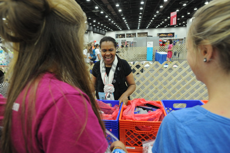 Women of the ELCA @ ELCA Youth Gathering | Detroit, Michigan, July 15-19 2015 |  Valora Starr, Women of the ELCA staff, laughs while helping the youth gather in-kind gifts.