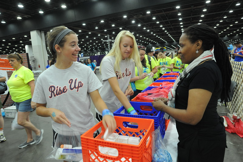 Women of the ELCA @ ELCA Youth Gathering | Detroit, Michigan, July 15-19 2015 | Haley Katencia, Christ Church, Quincy, Ill., and Erika Stollberg prepare hygiene bags for local organizations.