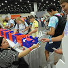 Women of the ELCA @ ELCA Youth Gathering | Detroit, Michigan, July 15-19 2015 | Gabriela Contreras, Women of the ELCA staff, hands out wristbands with the National Human Trafficking Resource Helpline phone number (888-373-7888).