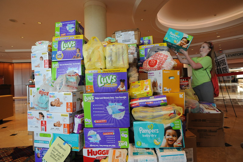 Women of the ELCA @ ELCA Youth Gathering | Detroit, Michigan, July 15-19 2015 | Lexy Grenier, 17, St. Mark's Lutheran, Grand Forks, N.D., places a box of diapers that she and the WELCA group in her church helped to collect.
