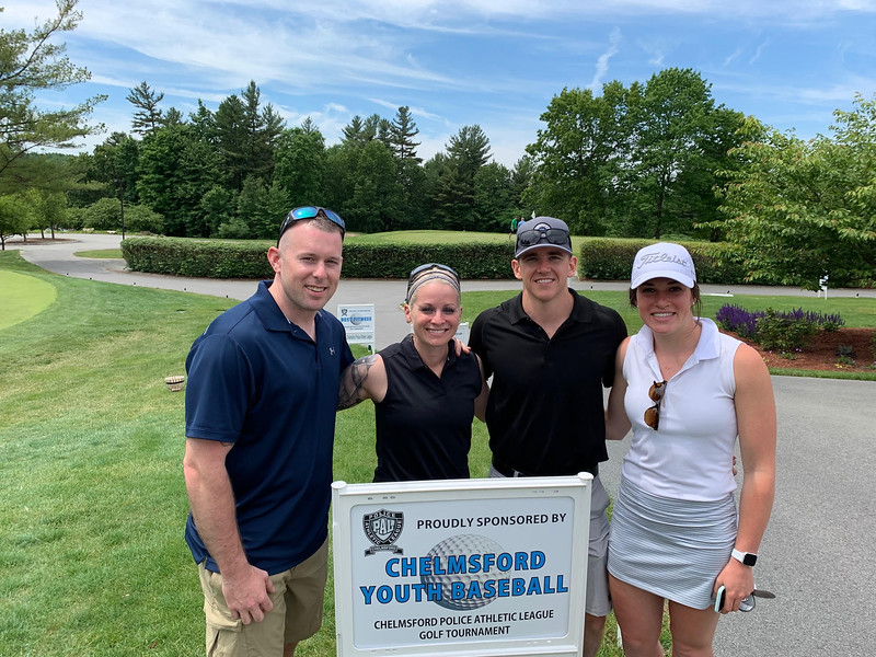 From left, State Police Officer Scott Gallant, Chelmsford Officer Ashley Gallant, Kyle Busby and Emily Loebs of Littleton