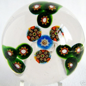 """DCP09446YVP Patterned Millefiori... Ysart/Vasart patterned millefiori paperweight with three groups of three same canes surrounding a center of four complex canes set on a clear ground, 2.55"""" x 1.775"""" and approximately 10.0 ozs. Concave fire-polished base with a slightly rough pontil mark area. No label. circa 1946 to 1956/59. Photo courtesy of Private Collector."""