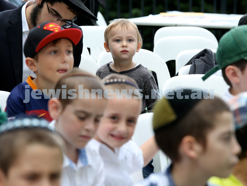 Yud Aleph Nissan Children's Rally at Tzemach Tzedek Synagogue. Mottel Moss look on. Pic Noel Kessel.