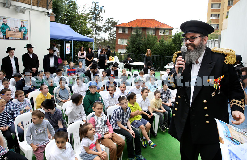 Yud Aleph Nissan Children's Rally at Tzemach Tzedek Synagogue. Rabbi Yehuda Straiton leads the rally. Pic Noel Kessel.
