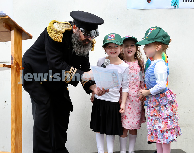Yud Aleph Nissan Children's Rally at Tzemach Tzedek Synagogue. Rabbi Yehuda Straiton reciting Pesukim with some children. Pic Noel Kessel.