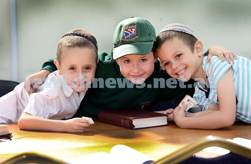 Yud Aleph Nissan Children's Rally at Tzemach Tzedek Synagogue. Avishai Kessel, Moshe Levitan, Moshe Schapiro. Pic Noel Kessel.