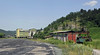 Banovici washery and Oskova, Bosnia-Hercegovina, Wed 11 June 2014 1.  Looking north.  The washery and standard gauge sidings are in the distance at left.  The 76cm gauge railway is at Oskova, on the hillside at right.  The loco at right is standard gauge 62-677.  62-125 was in the shed behind it.
