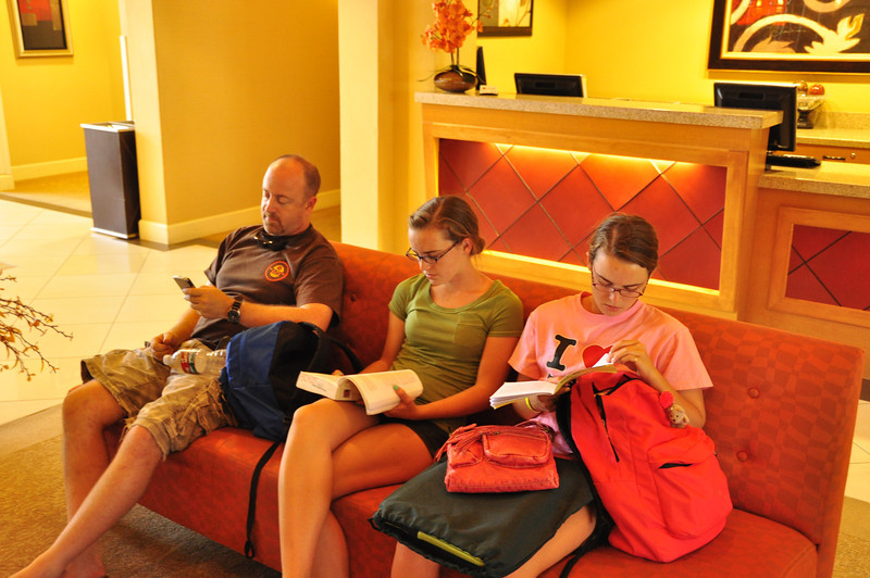 Craig, Renae and Nicole patiently waiting for check-in.