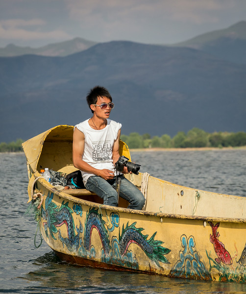 Er Hai Lake, China: well-equipped Chinese tourist in a traditionally decorated boat