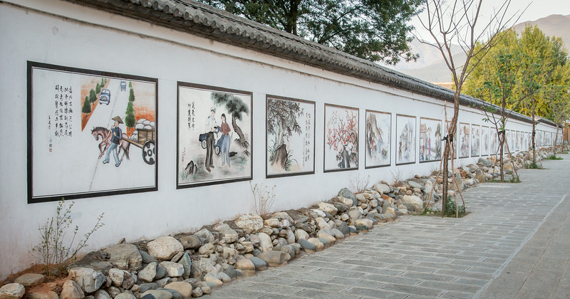 Xizhou, China: illustrated motivational posters are painted on the wall of a school.