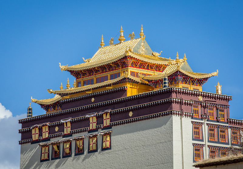 Shangri-La, China: the brilliantly colorful main building of the Ganden Sumtseling Monastery, the largest Tibetan Buddhist monastery in Yunnan province.