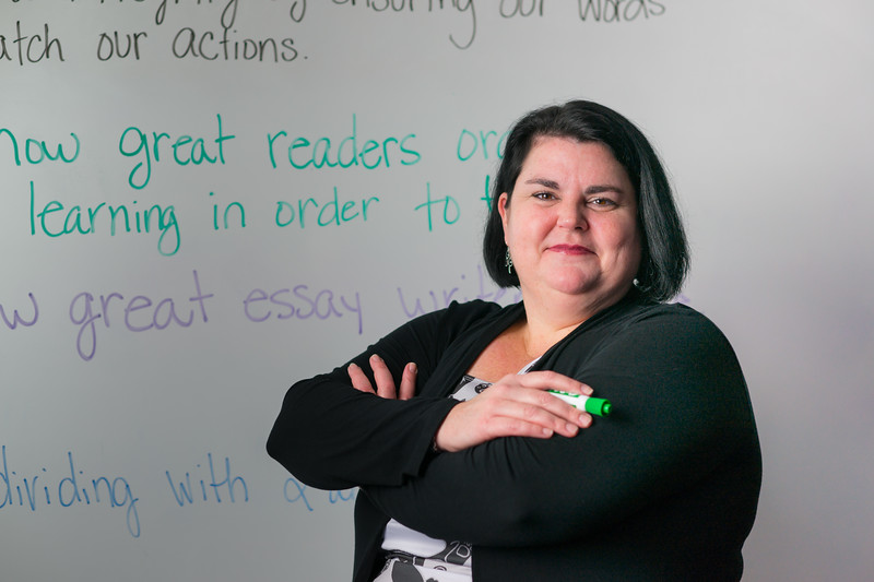 Royalty Free Stock Photo: Plus Size Teacher with Whiteboard