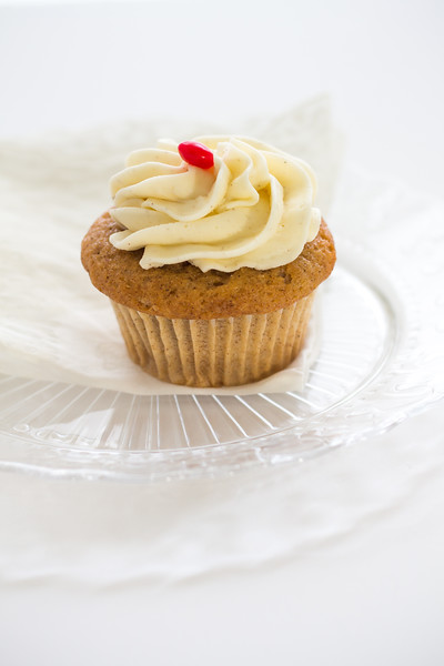 Intuitive Eating Stock Photo: Cupcake on Glass Serving Plate