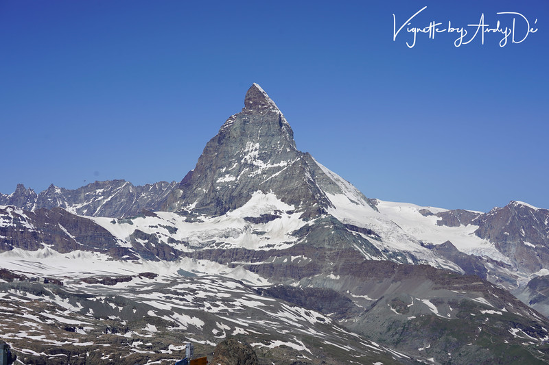 The Matterhorn is a mountain of the Alps, straddling the main watershed and border between Switzerland and Italy. It is a large, near-symmetrical pyramidal peak in the extended Monte Rosa area of the Pennine Alps, whose summit is 4,478 metres (14,692 ft) high, making it one of the highest summits in the Alps and Europe. The mountain overlooks the Swiss town of Zermatt, in the canton of Valais, to the north-east and the Italian town of Breuil-Cervinia in the Aosta Valley to the south. Just east of the Matterhorn is Theodul Pass, the main passage between the two valleys on its north and south sides, and a trade route since the Roman Era! To say it is overwhelming and ethereal in its beauty and appeal would be an understatement!