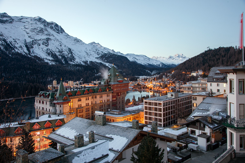 A panoramic picture scape of the beautiful and opulent city of St. Moritz at dawn.