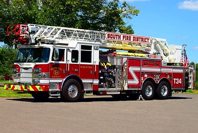 South District's Ladder 34, a 2016 Pierce Arrow XT 105ft RMA ladder truck (ex demo).