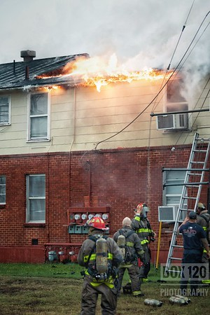 "Companies of the 1st, 2nd, and 3rd battalions worked a 2-11 apartment fire with a fatality in the 100blk of Camelot Ct on the cities Southwest side. Engine 12 and Engine 33 checked out with heavy smoke coming from the middle of a ""lightning bolt"" shaped apartment and advised that they had a working fire. Engine 12 forward laid a supply line and found heavy fire coming from division two of a two story apartment building. Crews went interior and found heavy fire on the 2nd floor that ultimately broke through the roof prompting Platform 33 to throw their main up, crews to back out, and command to drop a 2nd alarm. Multiple hand-lines were put to use and crews were able to transition back and made an interior attack. Crews operating on the second floor were informed of a possible victim in the origin apartment who was found deceased. Arson was requested and a cause was unknown when I cleared the scene. Companies on the ticket were EN08, EN12, EN13, EN15, EN16, EN25, EN33, TK08, TK33, PL11, HR11, MAC7, M16, M25, MOF5, FSO, BC01, BC02, BC06, FSC"