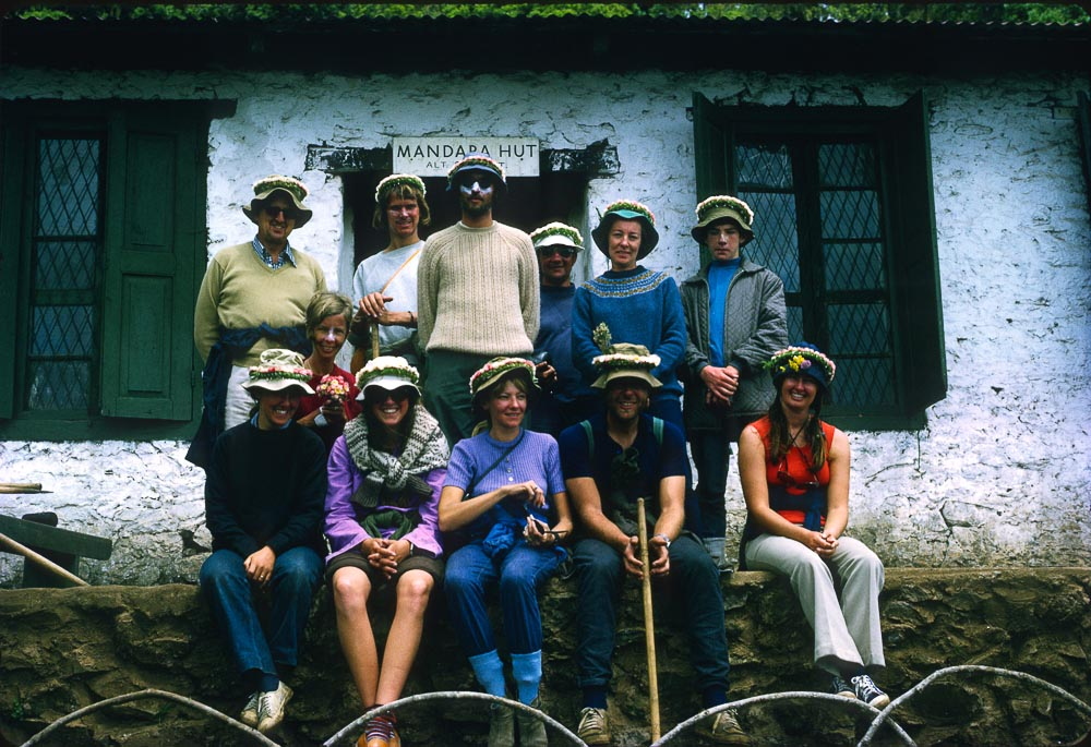 The Kilimanjaro crew at Mandara hut. Chris sitting far left. Fionna Hayden with Gary standing at right.