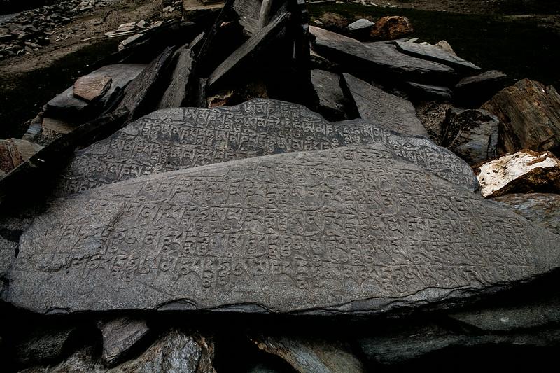 Rocks inscribed with Tibetan scriptures en route Zanskar