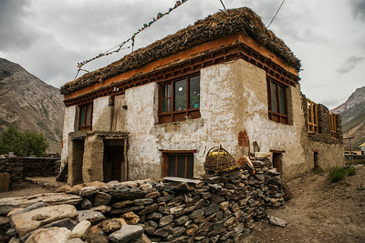 "Houses made with flat stones lined one above the other and ""cemented"" and painted with a mixture of mud, straw and dung are a typical architectural style of the Zanskar and Ladakh regions."