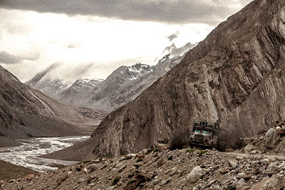 Our truck trudges through Penzi la, the only pass on the only motor-able road that connects Zanskar valley to the rest of India. Read more about Mountain passes we crossed in the Himalayas.