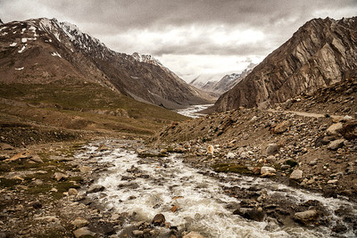 The rugged browns of the Greater Himalayas give company after crossing the Penzi la. Soon after Rangdum is Penzi la, the only mountain pass on the way to Zanskar. The water the glacier melt of Drang Drung glacier, the source of the Suru river.