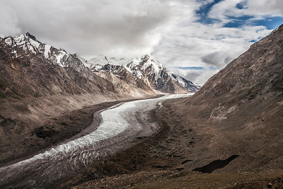 We saw the Drang Drung glacier after crossing the highest point at 4200 meters, of Penzi la, the only mountain pass en route Zanskar. It was an enormous glacier, melting in full flow at the peak of summer. Read more about Mountain passes we crossed in the Himalayas.