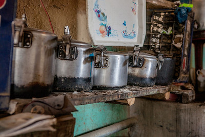 Five cookers, blackened by use in wood fired stoves are part of the kitchen in the homestay in Sani village of Zanskar valley, a remote and isolated valley in India.