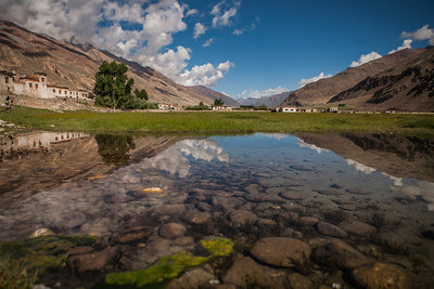 Holy lake Tuthot, with clear water and refelection of the cloudy sky surrounded by the Greater Himalayan mountain range in the village Sani an offbeat destination in the adventure valley of Zanskar