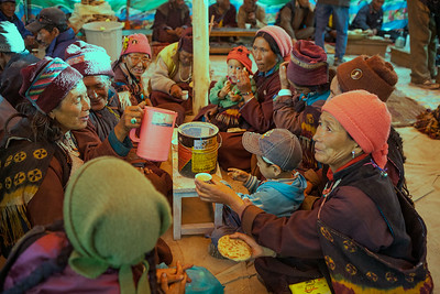 Old women dressed in the traditional Zanskar outfit enjoying the local brew called Chang at a wedding party in the Sani village of Zanskar, a remote and isolated valley in India.