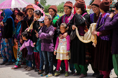 "Women hold ""Katha"" - the white scarf, to welcome the chief guest at the Sani monastery festival. A two-day riot of colour, dance and music, the Sani Festival is the perfect way to build a social camaraderie among the far-flung villages of the Zanskar valley."