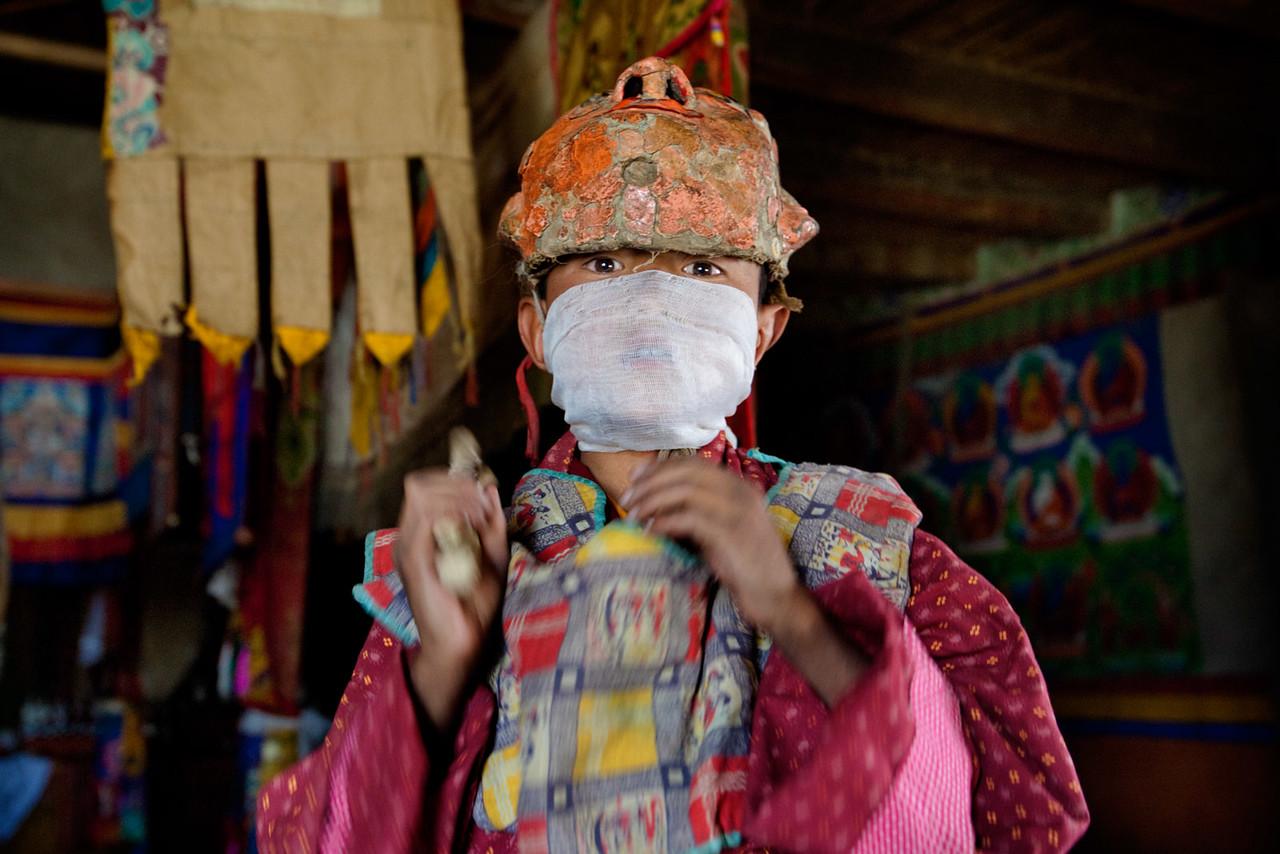 Dressing for the Cham (mask) dance. Karsha Monastery.