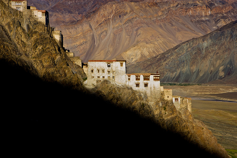 A monk is enjoying the view from the Karsha Monastry.