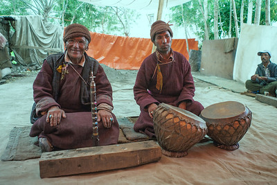 Two musicians dressed in traditional Zanskar attire play the musical instruments at a wedding party in Sani village in Zanskar, a remote and isolated valley in India
