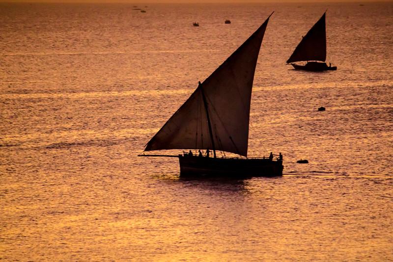 Silhouette of boat in ocean