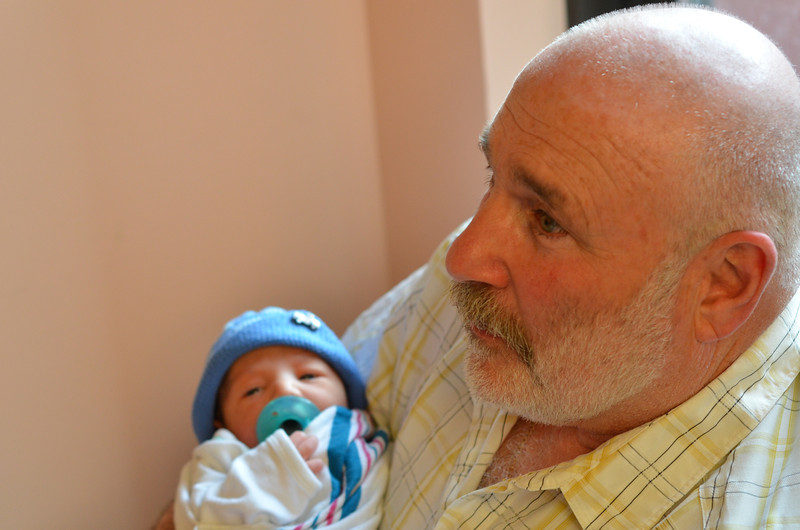 It's funny, he looks smaller in Grandpa's arms...