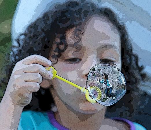 Eva blowing bubbles