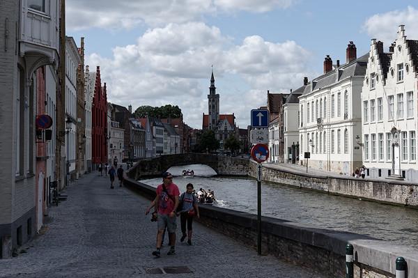 Tourists exploring Spiegelrei, Bruges, around noon