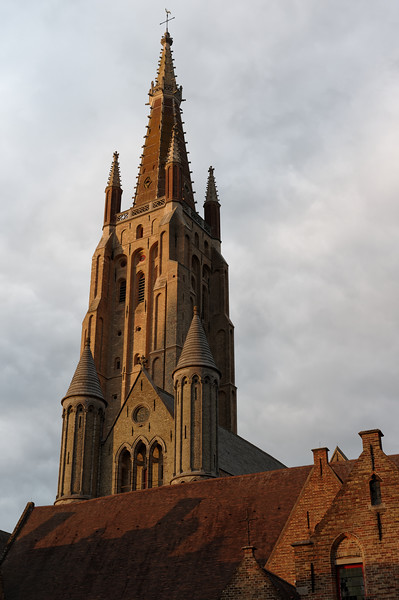 The spire of the Vrouwekerk catches the evening sun