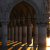 Sunrise through pillars, Venice, Italy