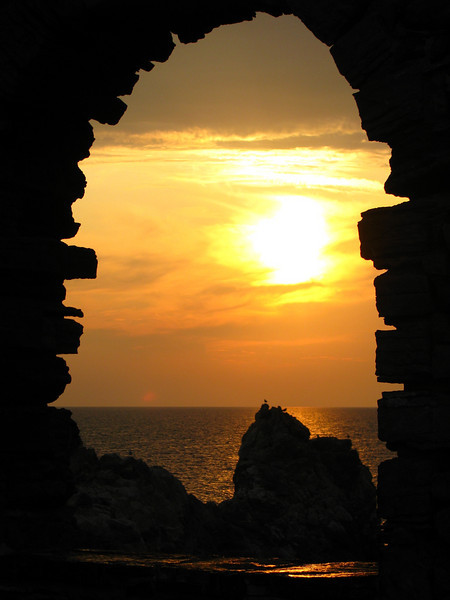 Sunset through rock window