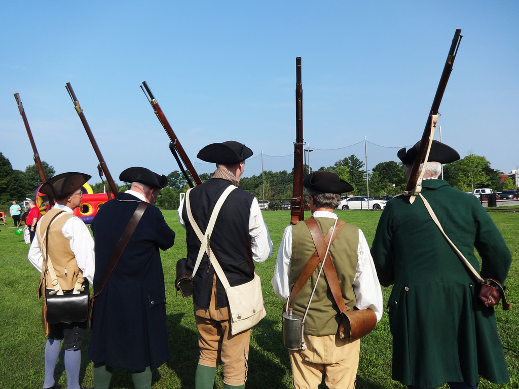 . The Billerica Colonial Minute Men prepared to shoot their muskets. Photo by Mary Leach